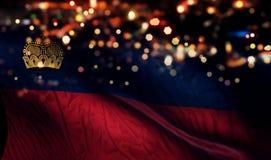Liechtensteinsk för Bokeh för nationsflaggaljusnatt bakgrund abstrakt begrepp Arkivfoto