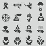 Liefdadigheid en schenkings zwarte pictogrammen vectorreeks Stock Foto