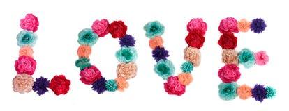 Liefde die met geïsoleerdei bloemen wordt geschreven stock afbeeldingen