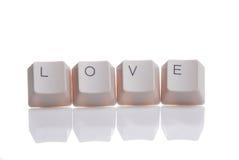 LIEFDE die met toetsenbordknopen wordt geschreven Stock Afbeelding