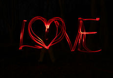 Liefde en hart - onduidelijk beeldfoto van rode lampen Stock Foto's