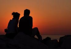 Liefde en zonsondergang Stock Foto's