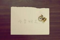 Liefde in Koreaan met ring Stock Foto