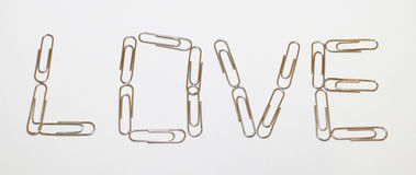 Liefde met paperclips Stock Foto's