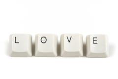 Liefde van verspreide toetsenbordsleutels op wit Royalty-vrije Stock Foto