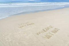 Liefde Vietnam Welkom die Vietnam in zand wordt geschreven Royalty-vrije Stock Afbeeldingen