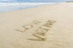 Liefde Vietnam in zand wordt geschreven dat Stock Afbeelding