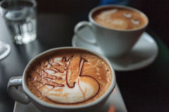 Liefde in vorm van een cappuccino Royalty-vrije Stock Afbeeldingen