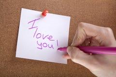 Liefde, witte sticker en de hand van een vrouw Stock Foto's