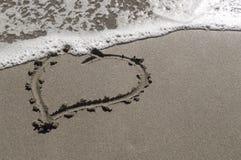 Liefde in zand Stock Afbeeldingen