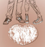 Liefdeachtergrond met benen van de man en de vrouw Royalty-vrije Stock Afbeelding