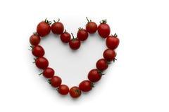Liefdehart uit tomaten wordt gemaakt die Royalty-vrije Stock Foto