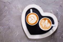 Liefdepaar van cappuccino Stock Afbeelding