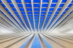 Liege abstract lines. Beautiful abstract view of the interior of the modern architecture railway station Liege-Guillemins with steel shapes and lines in the blue royalty free stock photo