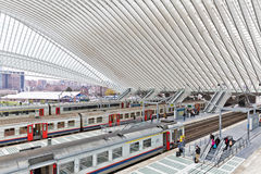 LIEGE, BELGIUM - December 2014: Platform with people waiting for. The train in the Liege-Guillemins railway station, designed by Santiago Calatrava Stock Photo