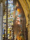 Interior detail from St. Paul`s Cathedral in Liege, Belgium, stained glass window and sunlight reflections royalty free stock photography