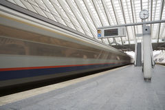 Liege-Guillemins railway station. LIEGE, BELGIUM  - 5 OCTOBER 2014: Train entering the Liege-Guillemins railway station, designed by Santiago Calatrava.  Photo Stock Photos