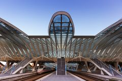 Liege Guillemins railway station Santiago Calatrava ICE train Be. Liege, Belgium - May 9, 2017: Liege Guillemins train railway station at twilight by Santiago Stock Photos