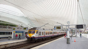 Liege railway station. LIEGE, BELGIUM - AUG 5, 2014: The Liege-Guillemins railway station. This station is made of steel, glass and white concrete designed by Royalty Free Stock Images