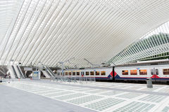 Liege station. LIEGE, BELGIUM - AUG 5, 2014: The Liege-Guillemins railway station. This station is made of steel, glass and white concrete designed by Spanish Stock Image