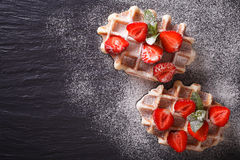 Liege waffles with fresh strawberries, powdered sugar closeup on Royalty Free Stock Photos