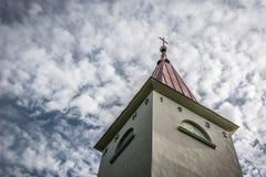 Lielvarde church. A church steeple against cloudy blue sky. Shot in Lielvarde, Latvia stock photos