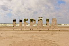 Liepaja, big mirroring letters on the beach. `Liepaja`  big mirroring letters on the beach of Liepaja, LAtvia on a cloudy day Stock Images
