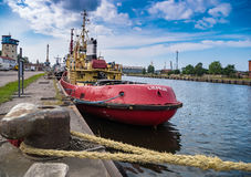 LIEPAJA, LATVIA - JULY 24, 2016: Tow boat moored in the harbour stock photography