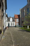 LIER, BELGIUM - APRIL 2016: typical beguine houses and cobblestone street Royalty Free Stock Image