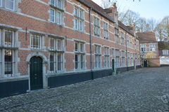 LIER, BELGIUM - APRIL 2016: typical beguine houses and cobblestone street Stock Image