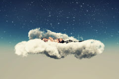 Pretty girl lies on a cloud Stock Photo