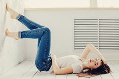 Lies on the floor. Beautiful girl lies on the floor Royalty Free Stock Photography