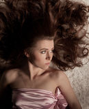 She lies stretched Royalty Free Stock Photo