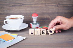 Lies. Wooden letters on dark background. Office desk Royalty Free Stock Photography