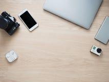 Lieu de travail avec l'appareil-photo de photo et le smartphone et le téléphone Image libre de droits