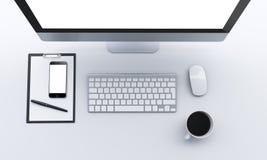Lieu de travail avec l'ordinateur portable, smartphone, café, bloc-notes Images stock