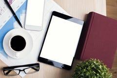 Lieu de travail avec le comprimé et le téléphone portable Photos libres de droits