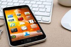 Lieu de travail avec le téléphone portable moderne Photo libre de droits