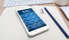 Lieu de travail avec le téléphone portable moderne Photographie stock libre de droits
