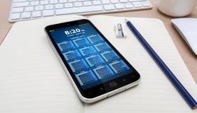 Lieu de travail avec le téléphone portable moderne Images libres de droits
