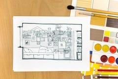 Lieu de travail de concepteurs avec des outils de peinture Images stock