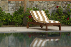 This is the life. Striped towel and deck chair royalty free stock photo