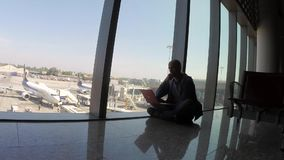 Life in the airport terminal. A man waiting for a flight stock video footage