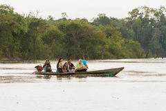 Life in the Amazons. AMAZON, BRAZIL - DECEMBER 31: Unknown people on a boat in the rain on Rio Negro in the Amazon River basin, Brazil, South America on December Royalty Free Stock Photos