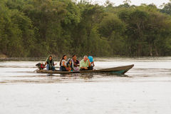 Life in the Amazons. AMAZON, BRAZIL - DECEMBER 31: Unknown people on a boat in the rain on Rio Negro in the Amazon River basin, Brazil, South America on December Royalty Free Stock Photography