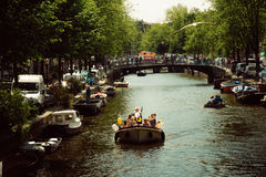 Life in Amsterdam, Netherlands. Fun life by the Amsterdam`s canals, Netherlands Royalty Free Stock Photos