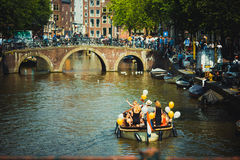 Life in Amsterdam, Netherlands. Fun life by the Amsterdam`s canals, Netherlands Royalty Free Stock Images