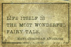 Life is Andersen. Life itself is the most wonderful fairy tale - famous Danish fairy tale writer Hans Christian Andersen quote printed on grunge vintage Stock Photo