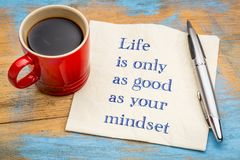 Life and mindset - inspiraitonal concept. Life is only as good as your mindset - handwriting on a napkin with a cup of coffee stock images