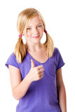 Life as a teenager is great. Beautiful cute happy smiling teenager girl with thumb up and pigtails feeling great, isolated Royalty Free Stock Image